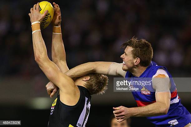 Nick Riewoldt of the Saints is hit high while marking against Jordan Roughead of the Bulldogs during the round 20 AFL match between the St Kilda...