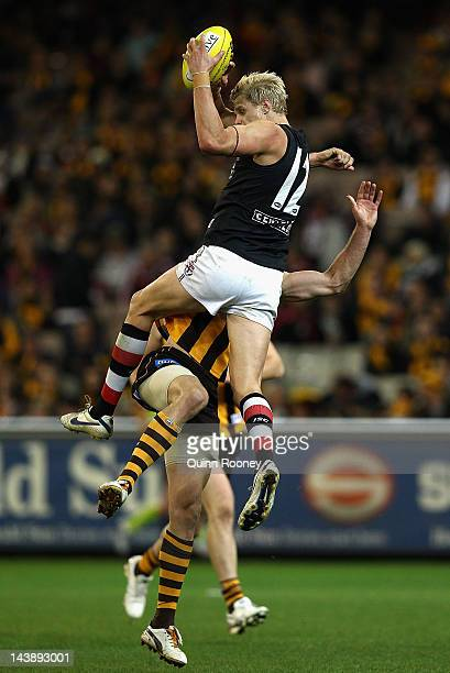 Nick Riewoldt of the Saints marks infront of Ryan Schoenmakers of the Hawks during the round six AFL match between the St Kilda Saints and the...