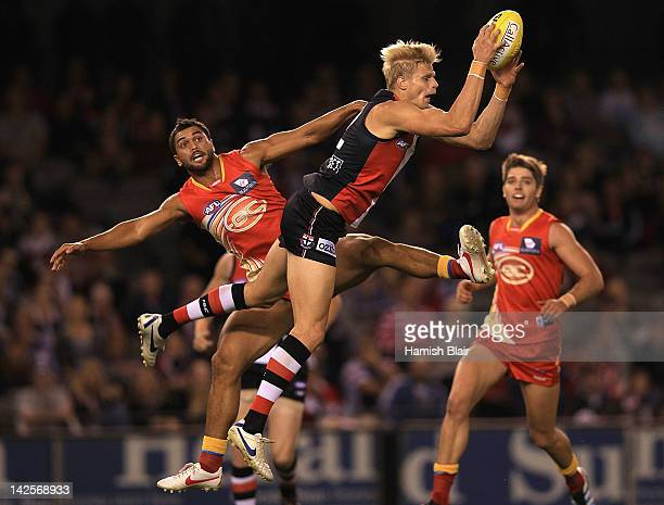 Nick Riewoldt of the Saints marks over Karmichael Hunt of the Suns during the round two AFL match between the St Kilda Saints and the Gold Coast Suns...