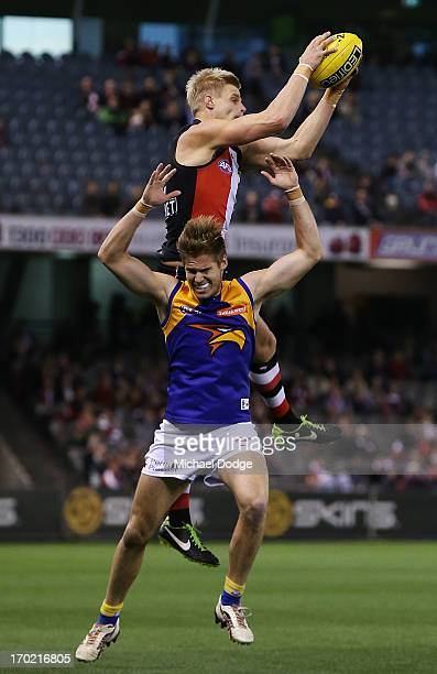 Nick Riewoldt of the Saints marks the ball over Eric McKenzie of the Eagles during the round 11 AFL match between the St Kilda Saints and the West...