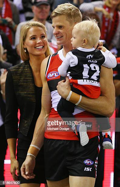 Nick Riewoldt of the Saints playing his 300th game leads the team out with his son James after getting him from wife Catherine during the round two...