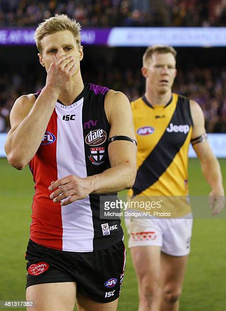 Nick Riewoldt of the Saints walks off after the final siren in front of Jack Riewoldt of the Tigers during the round 16 AFL match between the St...
