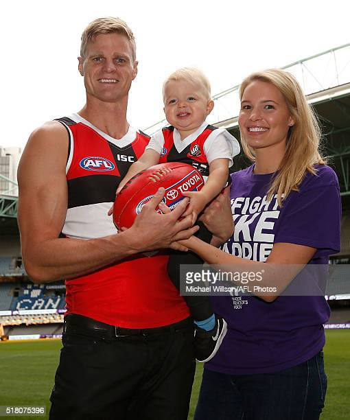 Nick Riewoldt of the St Kilda Saints son James and wife Catherine pose for the media ahead of his 300th AFL match at Etihad Stadium on March 30 2016...