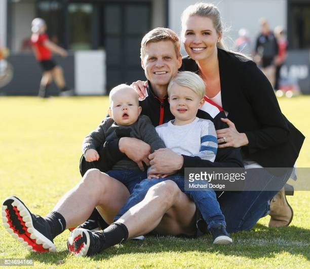 Nick Riewoldt poses with kids William and James and wife Catherine after announcing his retirement during a St Kilda Saints AFL press conference at...
