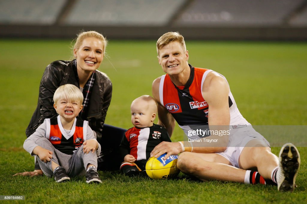Nick Riewoldt sits on the M.C.G. with his wife Catherine and sons James and William after playing his final game the round 23 AFL match between the Richmond Tigers and the St Kilda Saints at Melbourne Cricket Ground on August 27, 2017 in Melbourne, Australia.