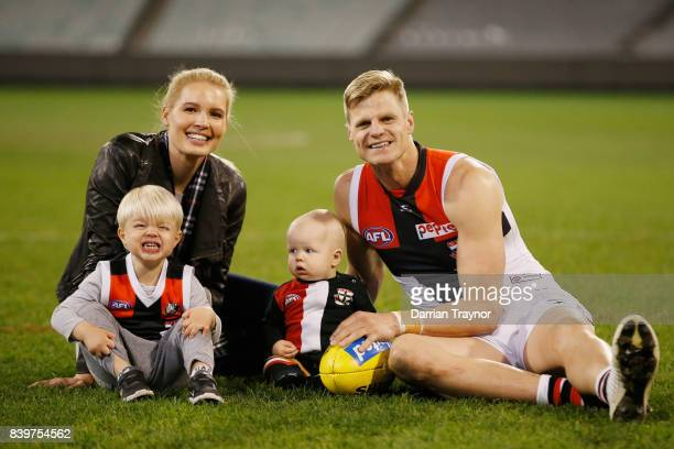 Nick Riewoldt sits on the MCG with his wife Catherine and sons James and William after playing his final game the round 23 AFL match between the...