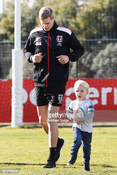 Nick Riewoldt watches his son James run with a football after he announces his retirement during a St Kilda Saints AFL press conference at Linen...