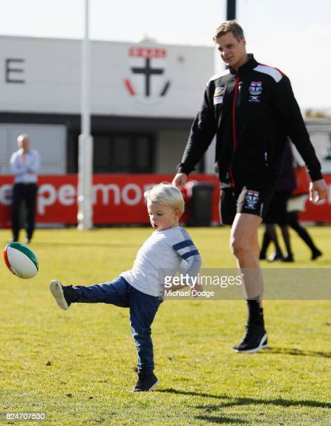 Nick Riewoldt watches son James kick a football after he announces his retirement during a St Kilda Saints AFL press conference at Linen House Oval...