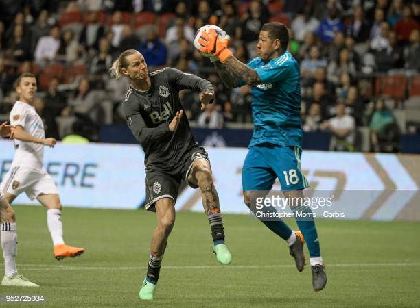 Nick Rimando goalkeeper of Real Salt Lake makes a save against Brek Shea of Vancouver Whitecaps at BC Place on April 27 2018 in Vancouver Canada