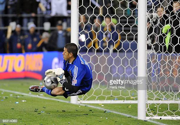 Nick Rimando of Real Salt Lake makes a save on a penalty kick by Edson Buddle of the Los Angeles Galaxy in the penalty shootout during the MLS Cup...