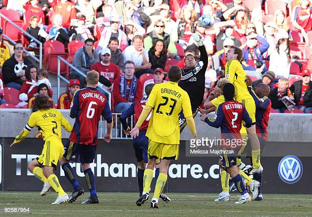 Nick Rimando of Real Salt Lake pokes the ball away from the Columbus Crew during the Conference Semifinals Game One at Rio Tinto Stadium on October...