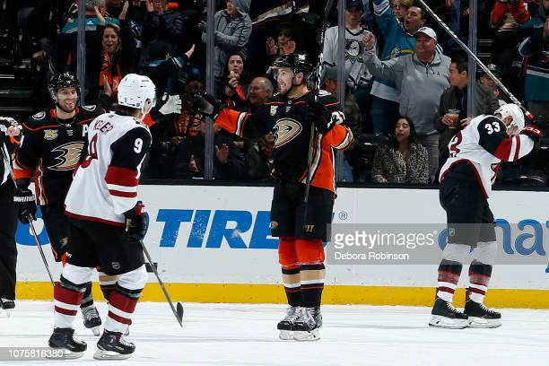 Nick Ritchie and Adam Henrique of the Anaheim Ducks celebrate a second period goal against Clayton Keller and Alex Goligoski of the Arizona Coyotes...