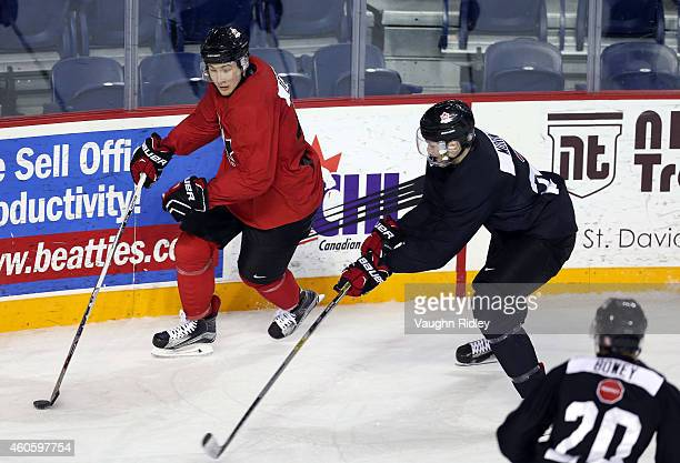 Nick Ritchie and Samuel Morin battle for the puck during the Canada National Junior Team practice at the Meridian Centre on December 17 2014 in St...