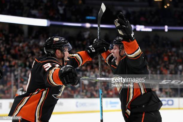 Nick Ritchie congratulates Ondrej Kase of the Anaheim Ducks on his third goal of a game against the Dallas Stars at Honda Center on December 12 2018...