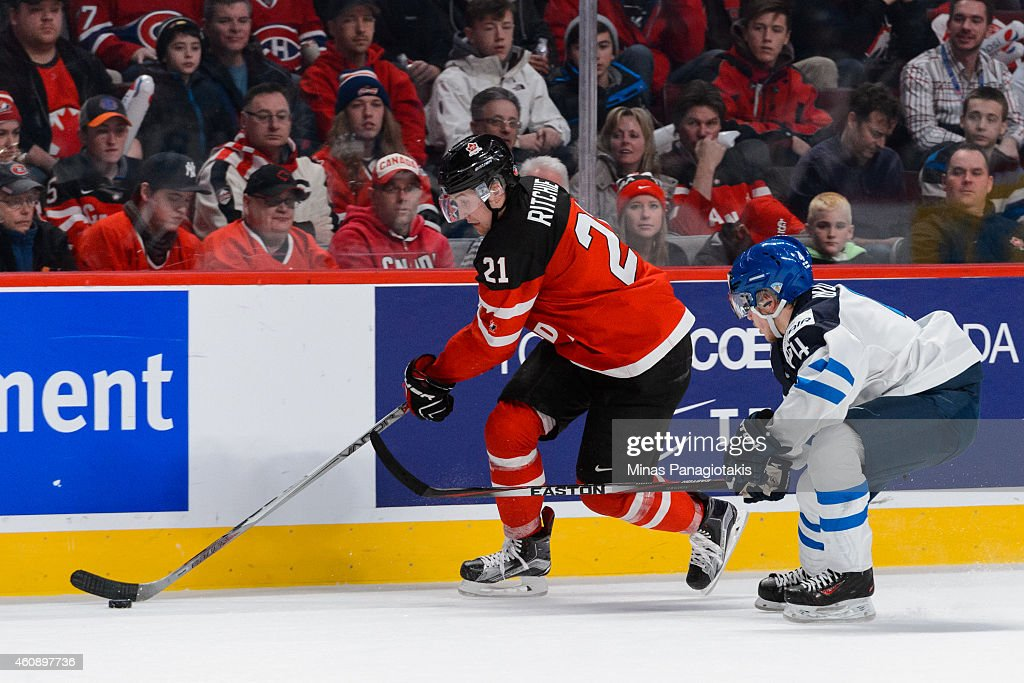Nick Ritchie #21 of Team Canada carries the puck with Mika Ilvonen #4 of Team Finland close behind during the 2015 IIHF World Junior Hockey Championship game at the Bell Centre on December 29, 2014 in Montreal, Quebec, Canada.