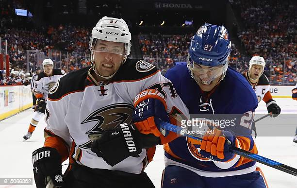 Nick Ritchie of the Anaheim Ducks and Anders Lee of the New York Islanders battle for position during the third period at the Barclays Center on...