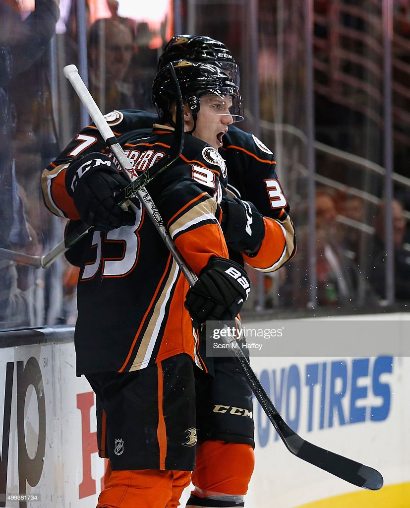 Nick Ritchie #37 of the Anaheim Ducks and Jakob Silfverberg #33 of the Anaheim Ducks react to a goal during the third period of a game at Honda Center on November 30, 2015 in Anaheim, California.