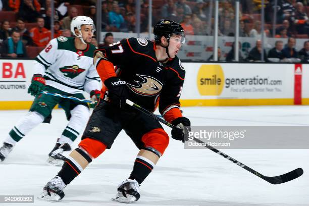 Nick Ritchie of the Anaheim Ducks and Jordan Greenway of the Minnesota Wild skate during the game on April 4 2018 at Honda Center in Anaheim...