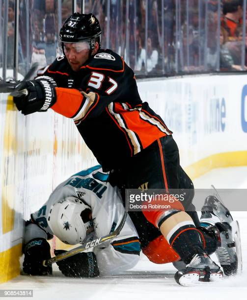Nick Ritchie of the Anaheim Ducks battles against Chris Tierney of the San Jose Sharks during the game on January 21 2018 at Honda Center in Anaheim...