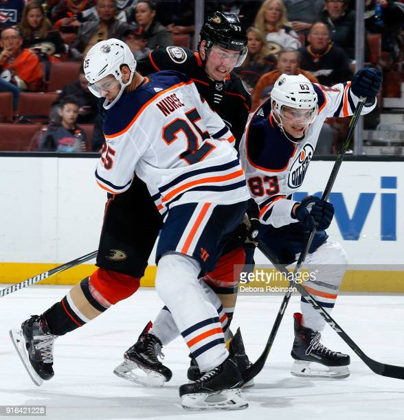 Nick Ritchie of the Anaheim Ducks battles for position against Darnell Nurse and Matthew Benning of the Edmonton Oilers during the game on February 9...