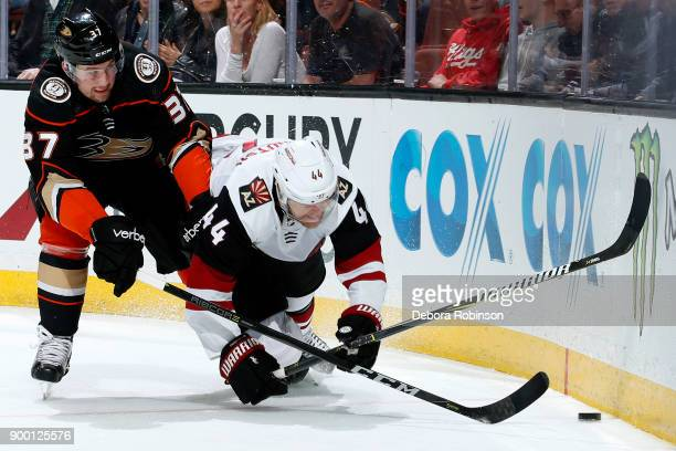Nick Ritchie of the Anaheim Ducks battles for the puck against Kevin Connauton of the Arizona Coyotes during the game on December 31 2017 at Honda...