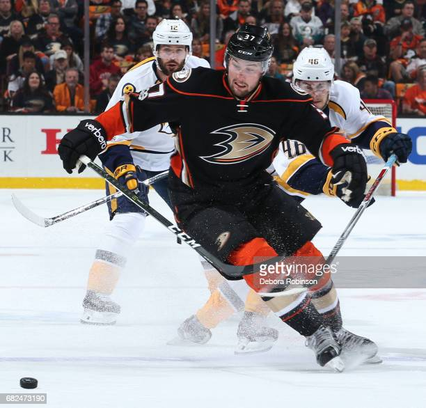 Nick Ritchie of the Anaheim Ducks battles for the puck against Pontus Aberg and Mike Fisher of the Nashville Predators in Game One of the Western...