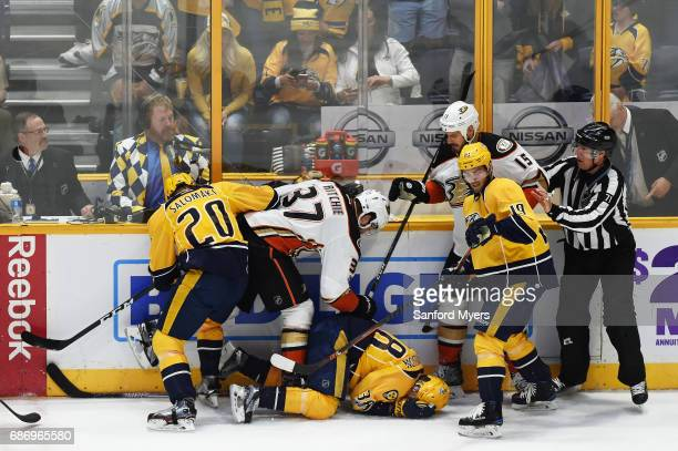 Nick Ritchie of the Anaheim Ducks boards Viktor Arvidsson of the Nashville Predators during the first period in Game Six of the Western Conference...