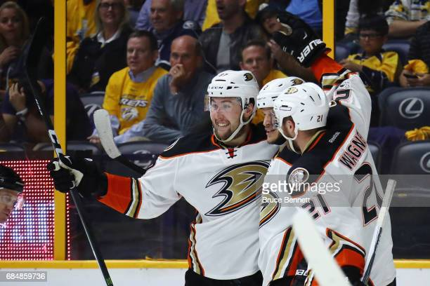 Nick Ritchie of the Anaheim Ducks celebrates with Kevin Bieksa and Chris Wagner after scoring a goal during the second period against Pekka Rinne of...