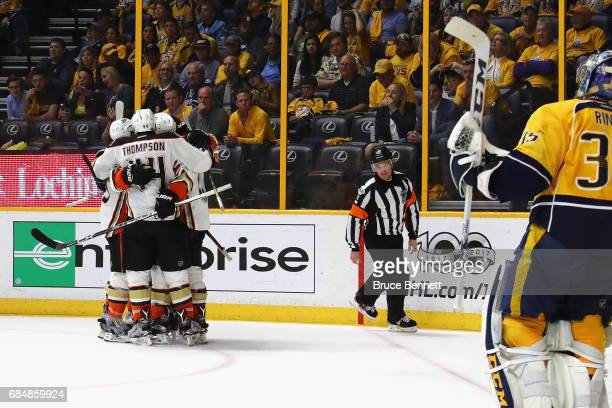 Nick Ritchie of the Anaheim Ducks celebrates with teammates after scoring a goal during the second period against Pekka Rinne of the Nashville...