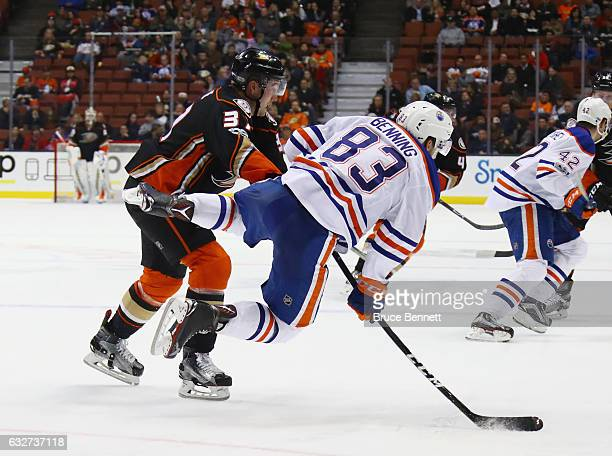 Nick Ritchie of the Anaheim Ducks checks Matthew Benning of the Edmonton Oilers during the third period at the Honda Center on January 25 2017 in...