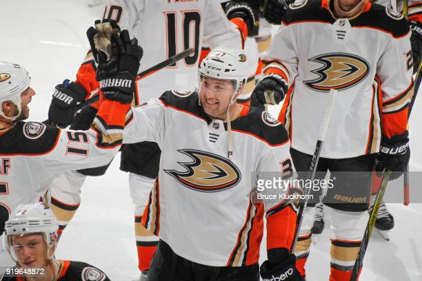 Nick Ritchie of the Anaheim Ducks is congratulated by his teammates after scoring the winning goal in the overtime shootout against the Minnesota...