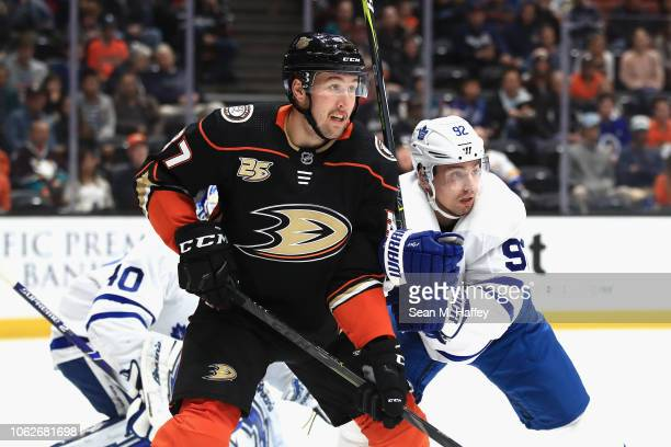 Nick Ritchie of the Anaheim Ducks is pushed by Igor Ozhiganov of the Toronto Maple Leafs during the first period of a game at Honda Center on...
