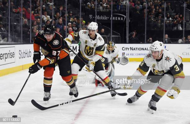 Nick Ritchie of the Anaheim Ducks skates with the puck against Luca Sbisa and Bayden McNabb of the Vegas Golden Knights in the third period of their...