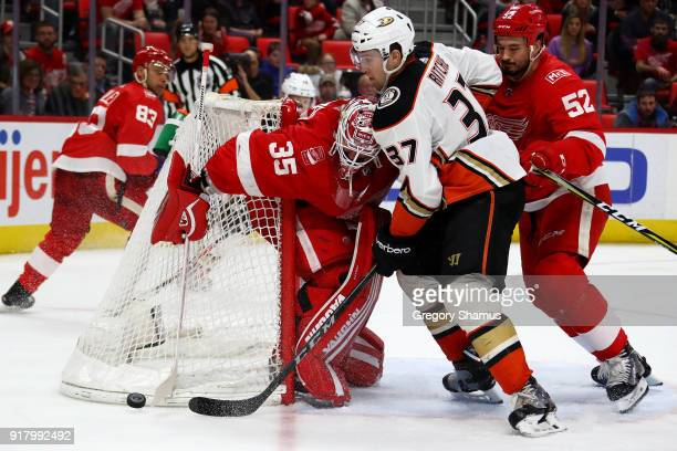 Nick Ritchie of the Anaheim Ducks tries to get a shot off on Jimmy Howard of the Detroit Red Wings during the third period at Little Caesars Arena on...