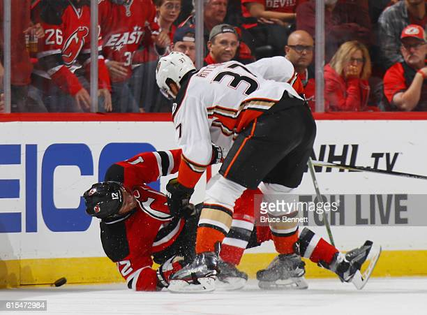 Nick Ritchie of the Anaheim Ducks trips up Ben Lovejoy of the New Jersey Devils during the first period at the Prudential Center on October 18 2016...