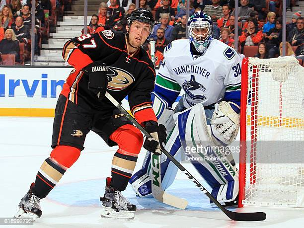 Nick Ritchie of the Anaheim Ducks waits for a pass to take a shot against Ryan Miller of the Vancouver Canucks on October 23 2016 at Honda Center in...