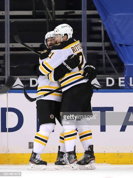 Nick Ritchie of the Boston Bruins is congratulated by Craig Smith after he scored a goal in the second period against the New York Rangers at Madison...