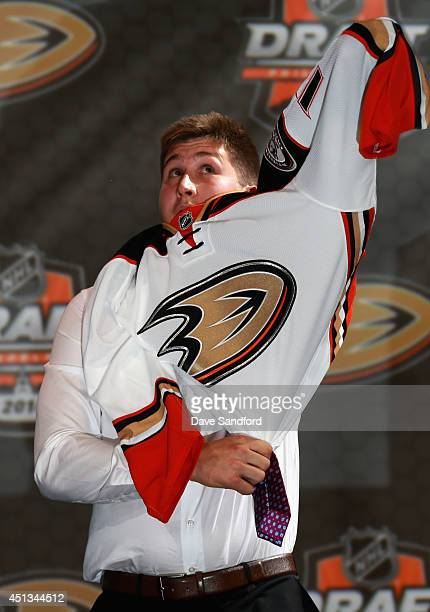 Nick Ritchie puts on his jersey after being selected tenth overall by the Anaheim Ducks during the 2014 NHL Entry Draft at Wells Fargo Center on June...