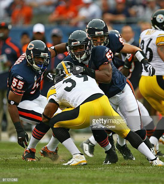 Nick Roach of the Chicago Bears brings down Willie Parker of the Pittsburgh Steelers as teammates Lance Briggs and Hunter Hillenmeyer close in on...