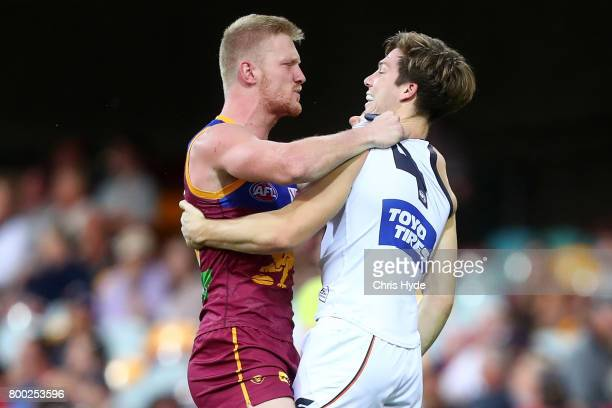 Nick Robertson of the Lions and Toby Greene of the Giants grapple during the round 14 AFL match between the Brisbane Lions and the Greater Western...