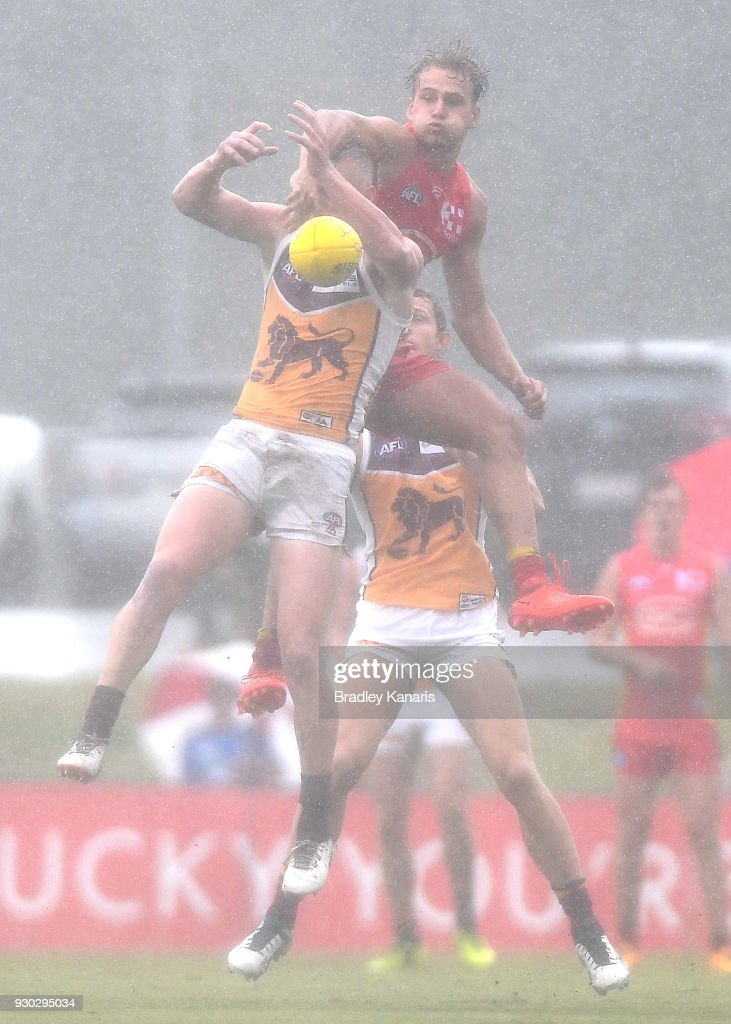 Nick Robertson of the Lions is pressured by the defence during the JLT Community Series AFL match between the Gold Coast Suns and the Brisbane Lions at Fankhauser Reserve on March 11, 2018 in Brisbane, Australia.