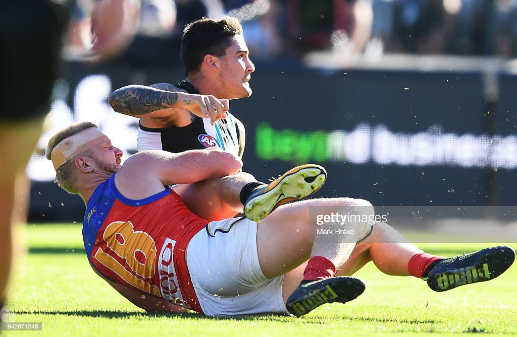 Nick Robertson of the Lions tackles Chad Wingard of Port Adelaide during the round three AFL match between the Port Adelaide Power and the Brisbane Lions at Adelaide Oval on April 7, 2018 in Adelaide, Australia.