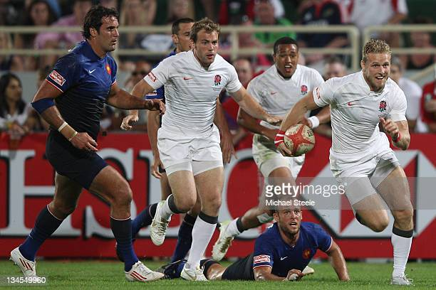 Nick Royle of England bursts through the France defence to score a try during the England v France match on Day Two of the IRB Dubai Sevens at the...