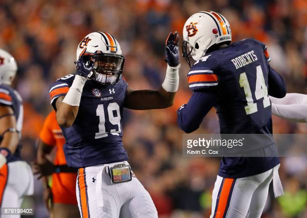Nick Ruffin and Stephen Roberts of the Auburn Tigers celebrate after the victory over the Alabama Crimson Tide at Jordan Hare Stadium on November 25...
