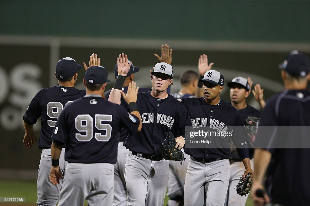 Nick Rumbelow #50 of the New York Yankees celebrates a win over the Boston Red Sox with his teammate on March 15, 2016 during the Spring Training Game at Jet Blue Park at Fenway South, Fort Myers, Florida. The Yankees defeated the Red Sox 6-3.