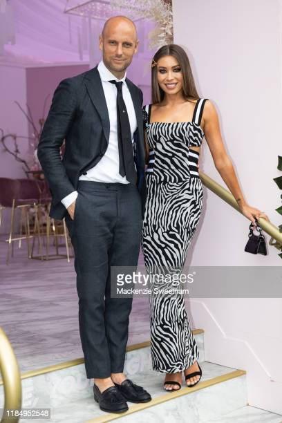 Nick Russian and Rozalia Russian poses in the Bumble marquee on Derby Day at Flemington Racecourse on November 02, 2019 in Melbourne, Australia.