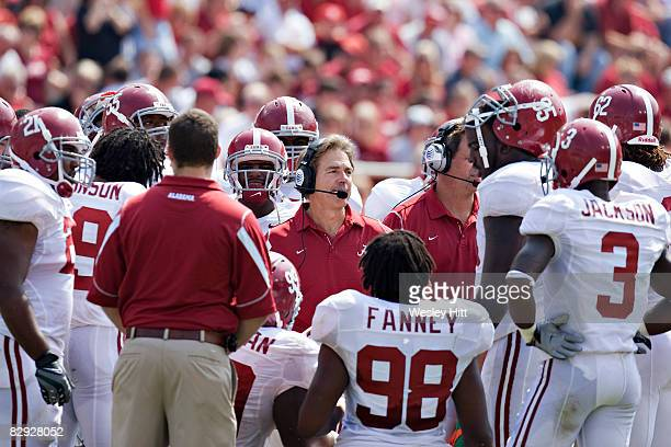 Nick Saban of the Alabama Crimson Tide talks to his team during a timeout against the Arkansas Razorbacks at Donald W Reynolds Stadium on September...