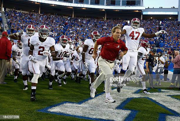 Nick Saban the head coach of the Alabama Crimson Tide leads his team on the field before the game against the Kentucky Wildcats at Commonwealth...