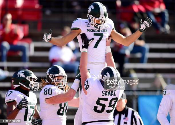 Nick Samac of the Michigan State Spartans lifts up Cody White after his touchdown in the first half of their game against the Rutgers Scarlet Knights...