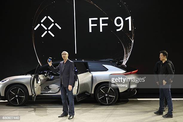 Nick Sampson senior vice president of research and development at Faraday Future left speaks as billioniare Jia Yueting founder and chief executive...